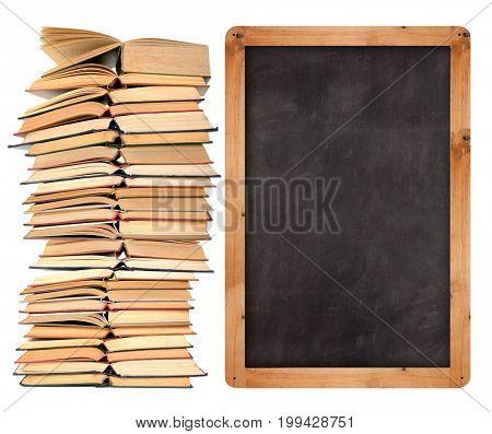 Stack of open  books with school blackboard