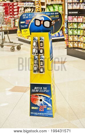 OREGON,USA-AUGUST 12, 2017: Solar Eclipse glasses displayed on stand in Fred Meyer grocery department.