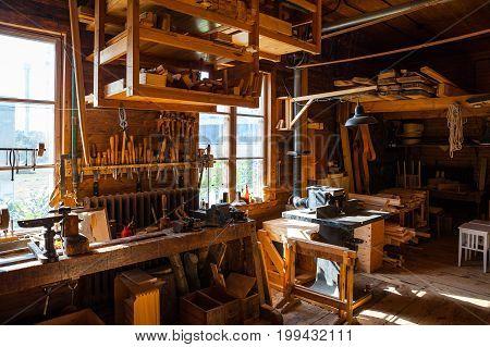 STOCKHOLM, SWEDEN - SEPTEMBER 18, 2016: Retro styled woodwork workshop room with many tools