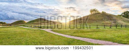 Panorama of Royal Mounds on sunset in Gamla Uppsala Uppland Sweden