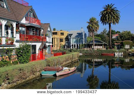 View at the Mission Creek river in Santa Barbara during a hot sunny day. Residence houses showing on both sides of this river that floats in the middle of the city next to the State Street.