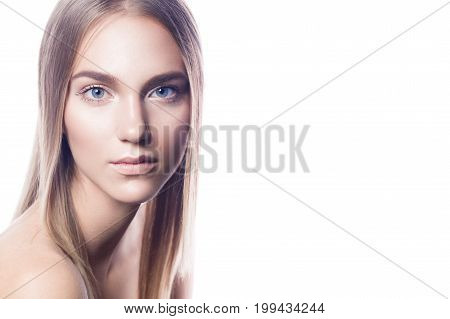 Woman with nude makeap on a white background