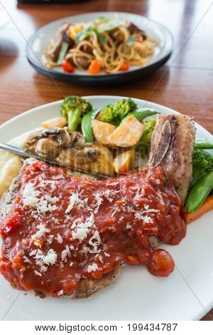 pork chop steak with red tomato sauce one of delicious meat menu