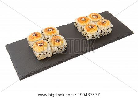 Japanese Food. Baked Sushi On A Black Slate Surface, Menu Concept. Isolated On White