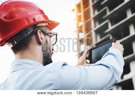 Engineer Inspector For Construction Of Industrial Facilities Works On Construction Site. Portrait Of