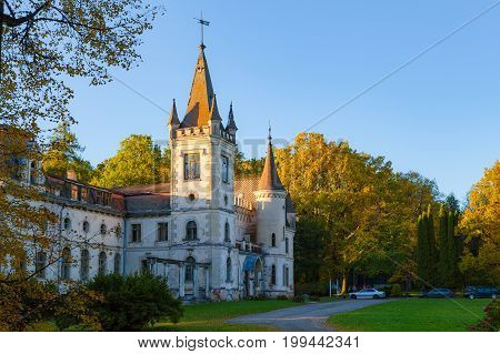 Old fairy-tale palace in Stameriena, Latvia. Fall time, bright colors at sunset