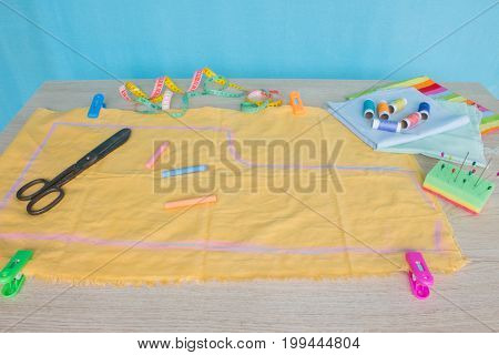 Furniture and equipment for sewing in designer sewing workshop. tools for sewing for hobby. instruments sewing craft on wooden background close up