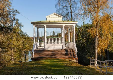 White wooden pavilion with the forest. Luxury viewpoint on the hill.