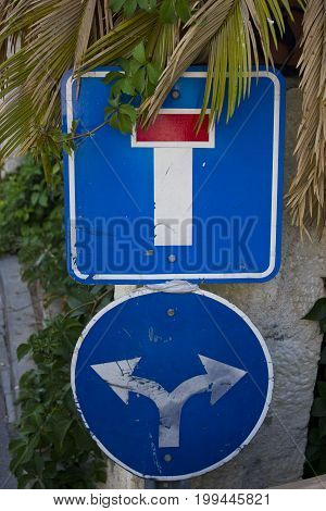 Blue and red road signs in Antalya Turkey