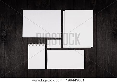 Corporate identity template stationery set on black stylish wood background. Mock up for branding business presentations and portfolios.