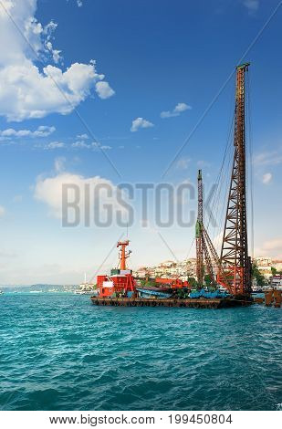 Cargo ship at the harbour of Bosphorus in Istanbul, Turkey