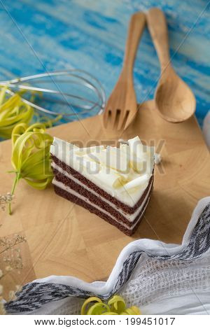 Chocolate Cake And White Chocolate On Wood Plate. Cake Background Concept