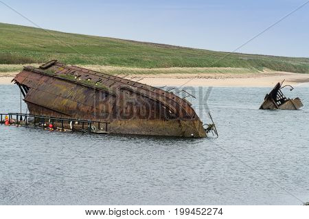 Blockships deliberately sunk in the smaller entrances to Scapa Flow a major Royal Navy anchorage to prevent enemy attacks during world war one.SS Reginald Weddel Sound Scapa Flow Orkney Scotland UK