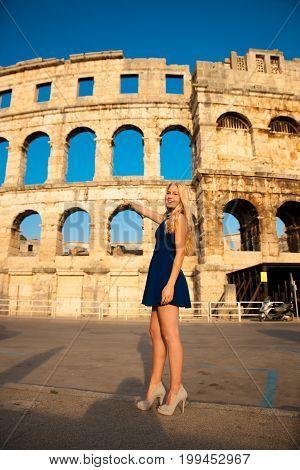beautiful young woman turist taking photos of roman arena in Pula croatia