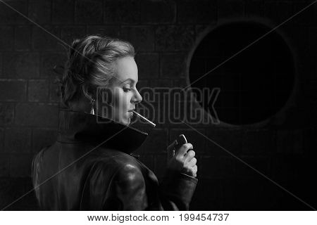 Woman In Brown Leather Coat With Lighter And Cigarette