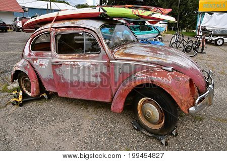 BATTLE LAKE, MINNESOTA, August 11, 2017: The 1960`s old car is a product of Volkswagen Group, one of the world`s largest car industries in the world founded in Berlin in 1937.