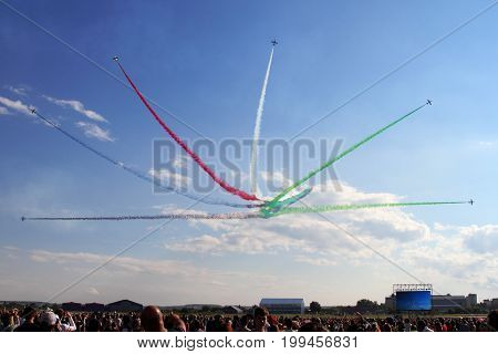 Moscow Region - July 21 2017: Visitors to the MAKS air show monitor the performance of the aerobatic team.