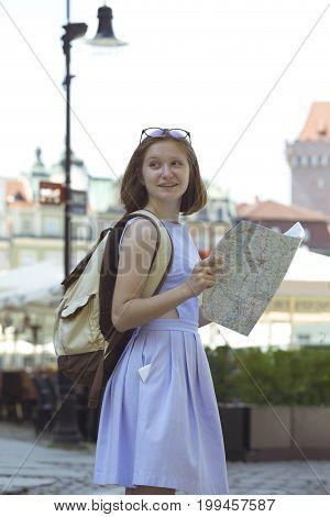 Girl Looking At The Map Standing At The Main Square Rynek Of Poznan