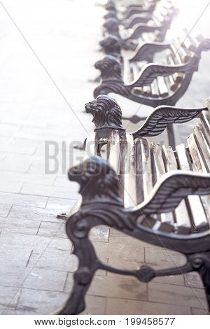 Beautiful old benches on the street of a European city