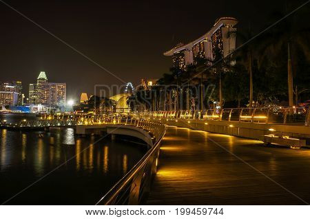SINGAPORE - JUNE 17, 2014 :Walkway beside Marina Bay Sands Hotel at night time.