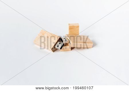 Light Wooden Usb Flash Drive On A White Isolated Background. Copy Space.