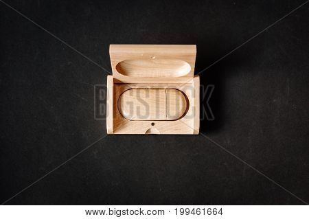 Packaging For Usb Drives. Wooden Box With Usb-stick For A Photographer, On A Dark Background. Top Vi