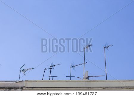 UHF Antennas in the roof on blue sky.