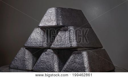 Tin/lead/silver ingots bullion glittering in a pyramid formation