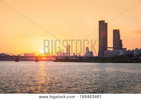 Sunsets Behind The Skyscrapers Of Yeouido And Bridges Across The Han River In Downtown Seoul, South