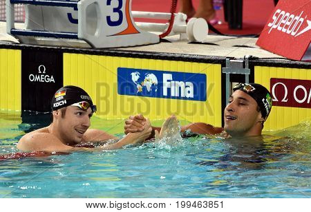 Hong Kong China - Oct 30 2016. Competitive swimmer LIMA Felipe (BRA) and KOCH Marco (GER) after the Men's Breaststroke 100m Final. FINA Swimming World Cup Victoria Park Swimming Pool