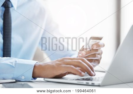 E-commerce And Modern Technology. Cropped Shot Of Unrecognizable Black Male In Blue Shirt With Tie K