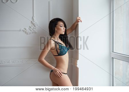 Perfect, sexy body, belly and breast of young woman wearing seductive lingerie. Beautiful hot female in underware posing in sensual way.