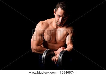 Fitness concept. Muscular and sexy torso of young man having perfect abs, bicep and chest. Male hunk with athletic body holding dumbbell