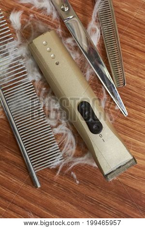Animal grooming tools set. Hair clipper, comb and scissors.