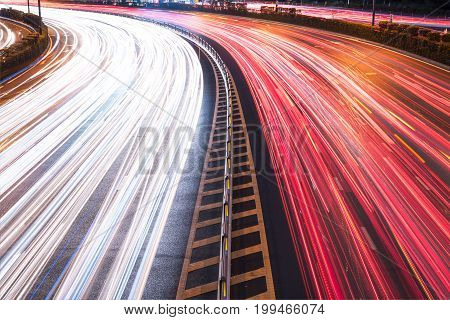 Cars light trails on a curved highway at night, Chengdu, China