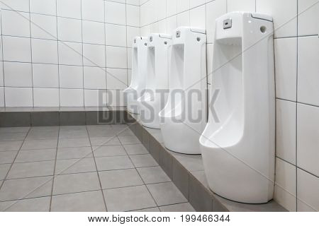 Modern Clean Hygienic Men Urinal Ware In Public Washroom Toilet