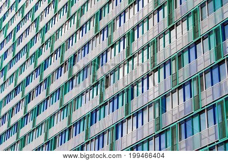 Balconies And Windows Of A Building, Apartment Houses Textured Beige Green Lattices