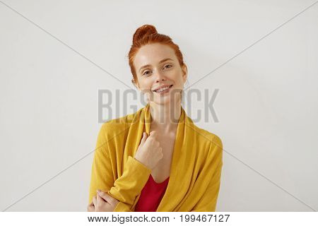 Adorable Young Female With Ginger Hair, Freckles And Shining Eyes Full Of Happiness, Wearing Yellow