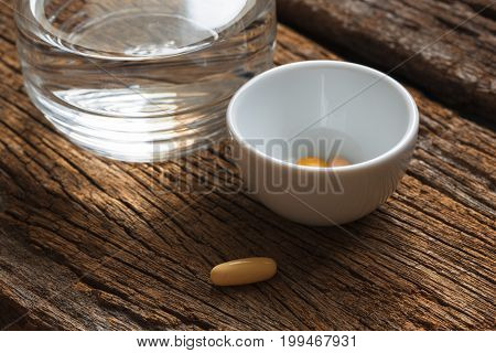 Medications and a glass of clear water