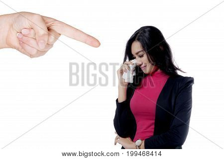 Photo of a beautiful business woman looks sad while getting intimidated by someone isolated on white background