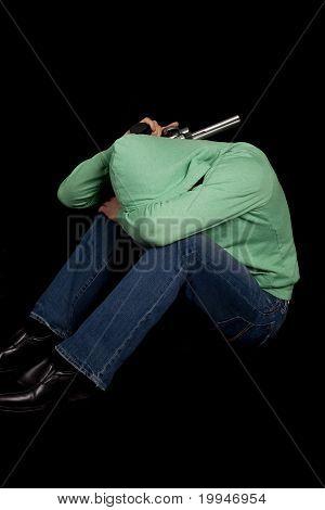Man Green Hoodie Head Down Gun