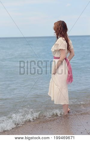 portrait of vintage woman wadding in the sea