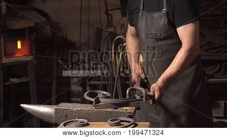 Treatment of molten metal close-up. Handmade blacksmith