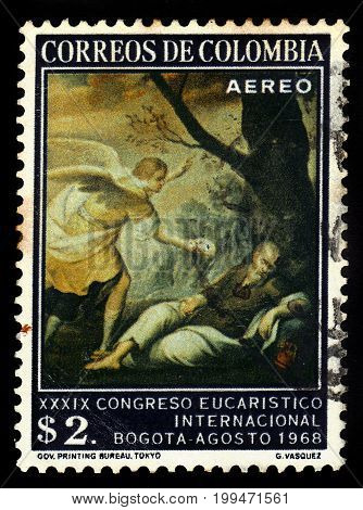 Colombia - circa 1968: A stamp printed in Colombia shows Dream of the Prophet Elias, painting by G.Vasquez, series 39th eucharistic congress, circa 1968