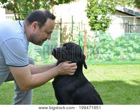Man Talking To His Dog