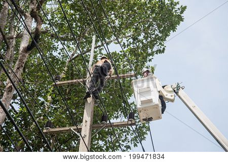 Electricians Repairing Wire