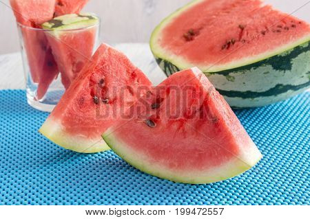 Juicy pieces of watermelon on a blue napkin