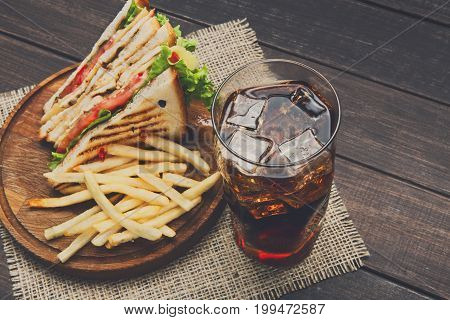 Fast food meals at sandwich bar, french fries with chicken toast and glass of cola, takeaway composition