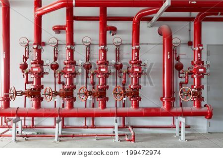 Red water pipe valvepipe for water piping system control in industrial building