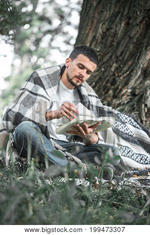 The Young Man At The Tree Reading A Book